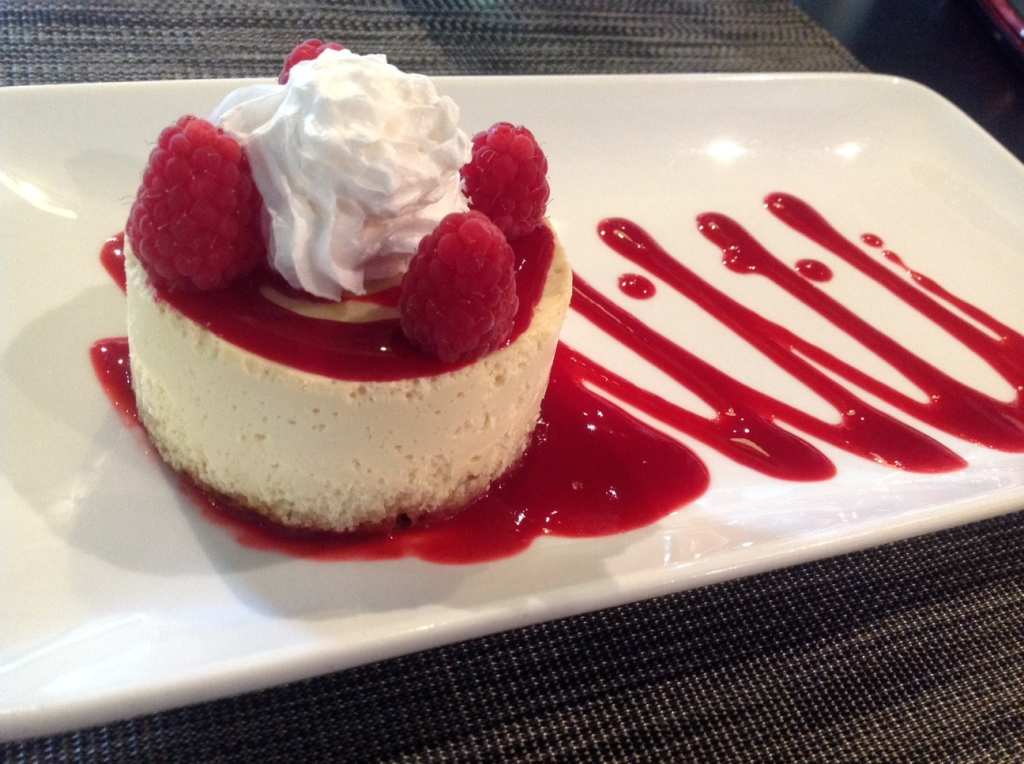 White Chocolate Cheesecake with Raspberry Sauce